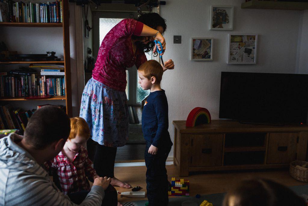 mom cutting her boy's hair