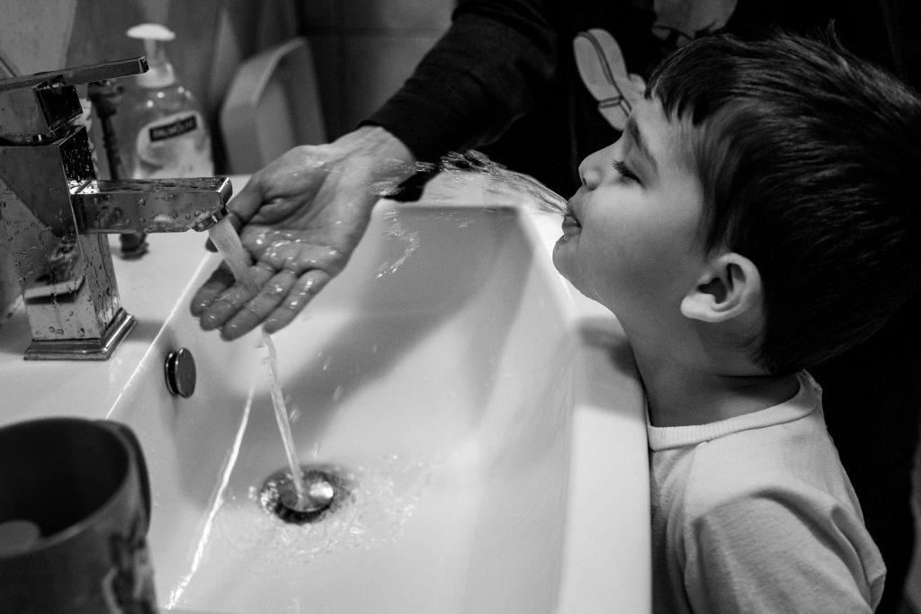 Boy washing his teeth.