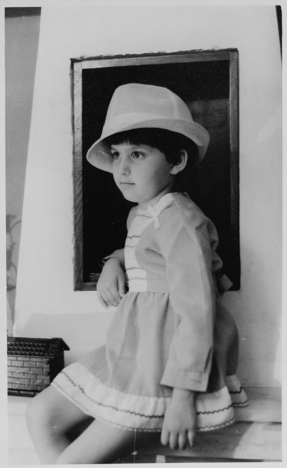Little girl with white hat.