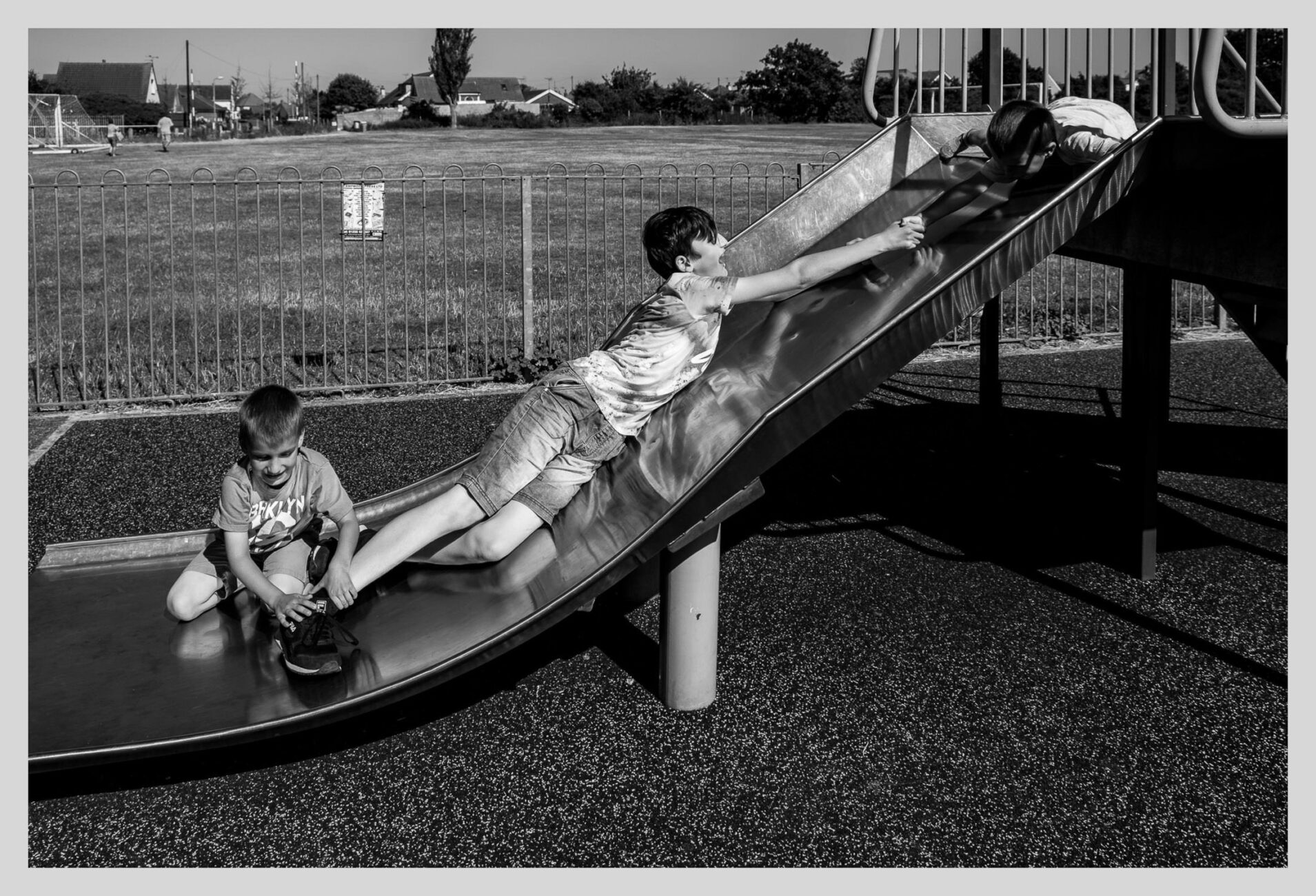 big brother playing with little brothers at the playground