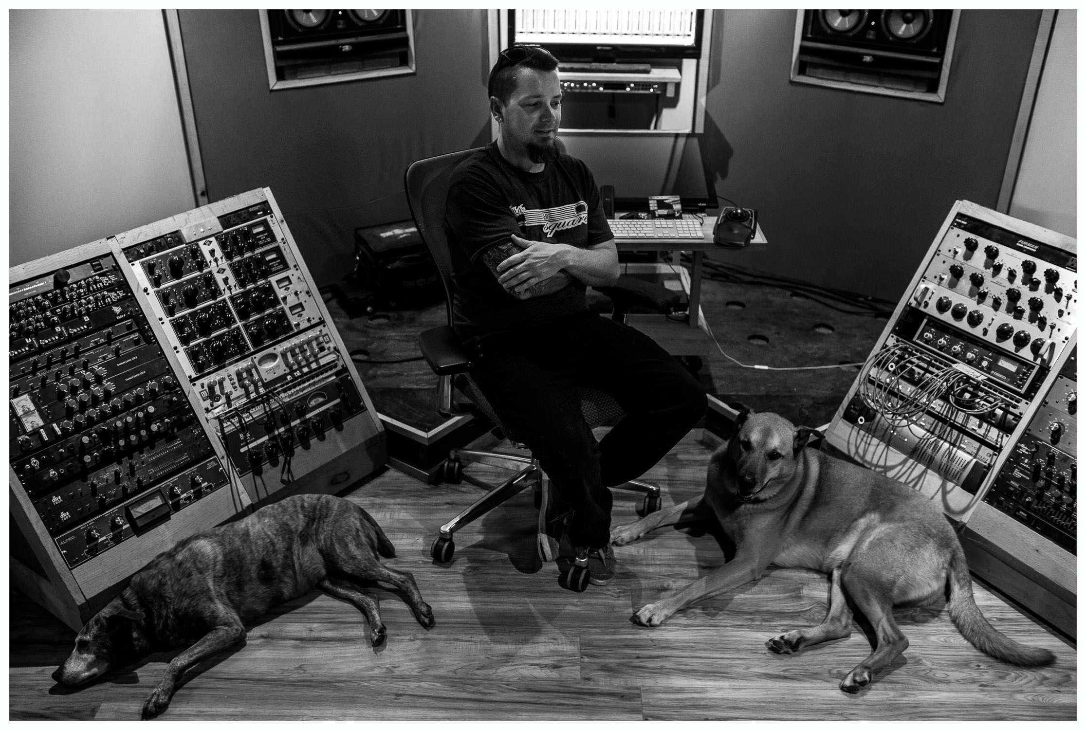 recoding studio USA musician with his 2 dogs