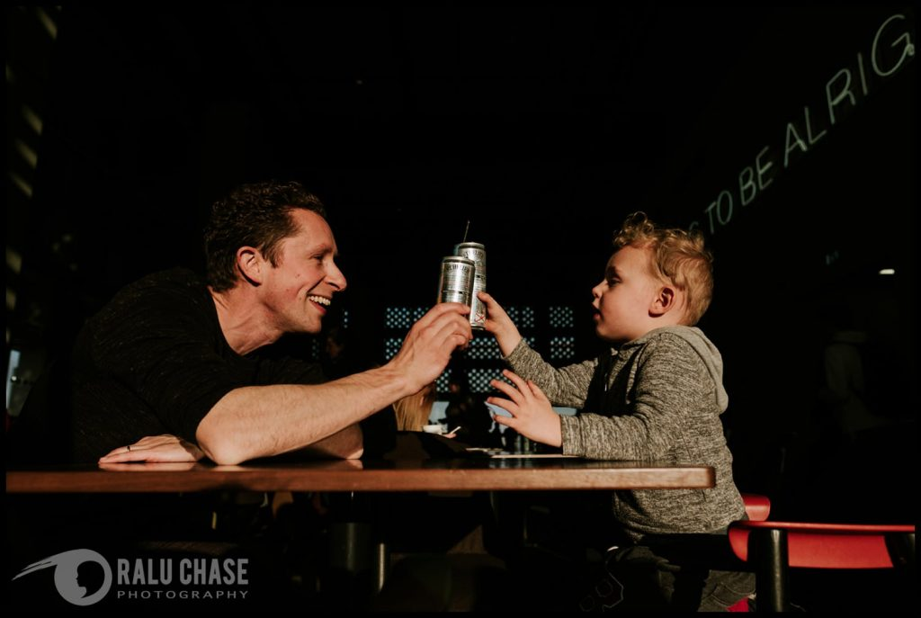 little boy and dad having a drink at the restaurant at the top of the Tate Modern Museum. photographed by a London family photographer