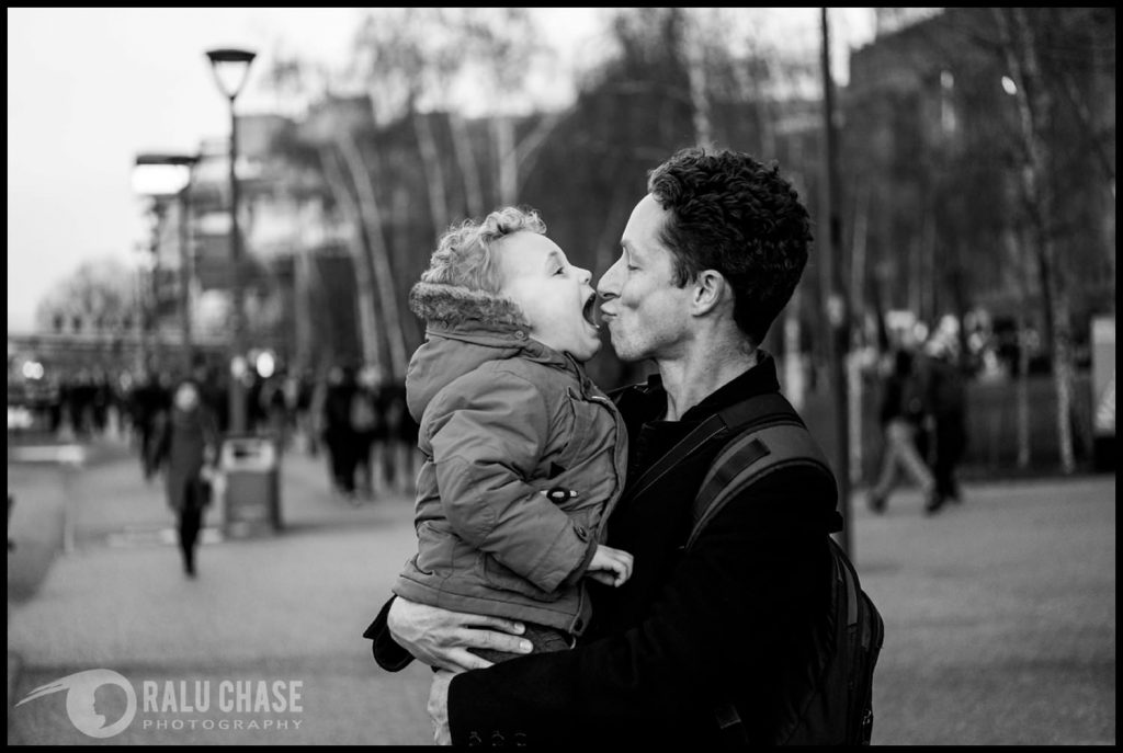 a little boy giving dad a kiss on his nose near the Tate Modern - London family photographer
