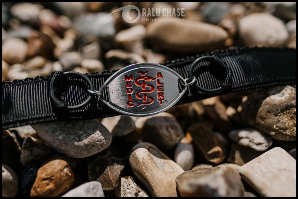 a detail shot of a medic alert bracelet set on the rocks of Holland on Sea beach