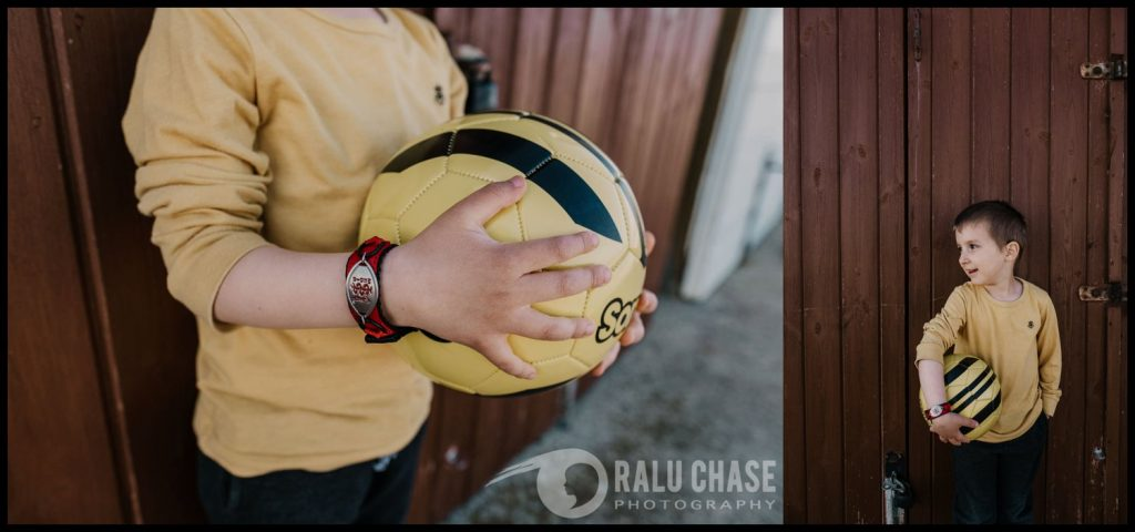 two images combined together. the first photo is a detail shot of the heands of a small boy holding a football and wearing a medical ID bracelet. Photographed by personal branding photographer Ralu chase. the second image is of the boy standing up against a beach shed and still holding his football.