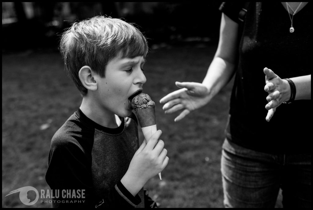 boy eating ice cream in the gardens near London's parliament building