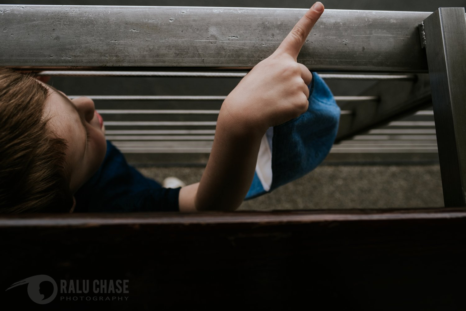 little boy pointing to one of the boats on the Thames