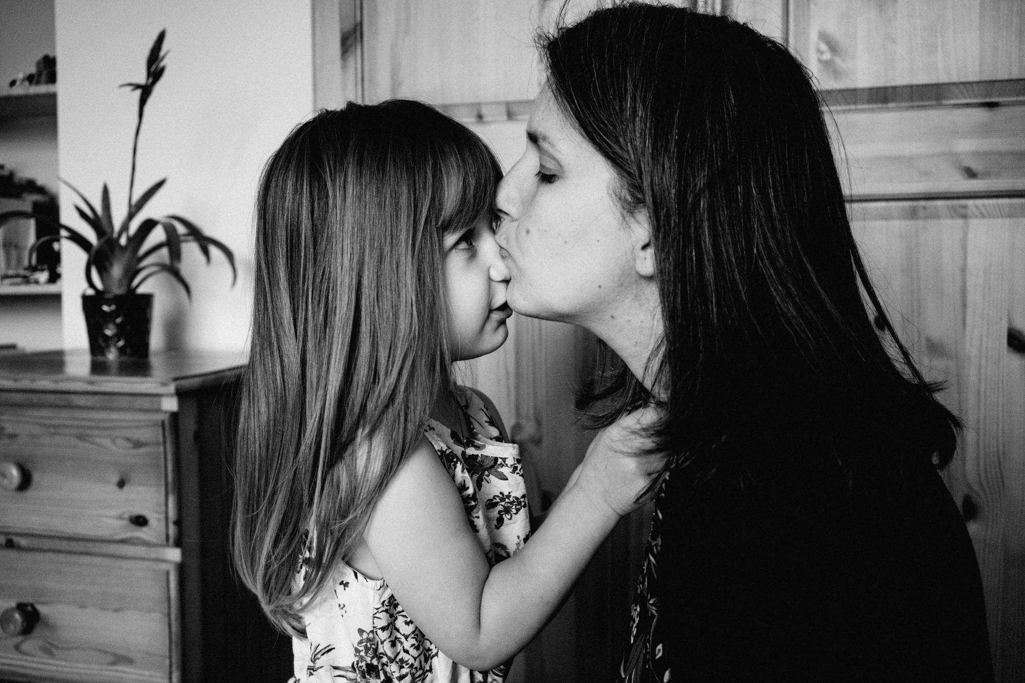 mom - a Colchester family photographer - kissing her little girl's nose