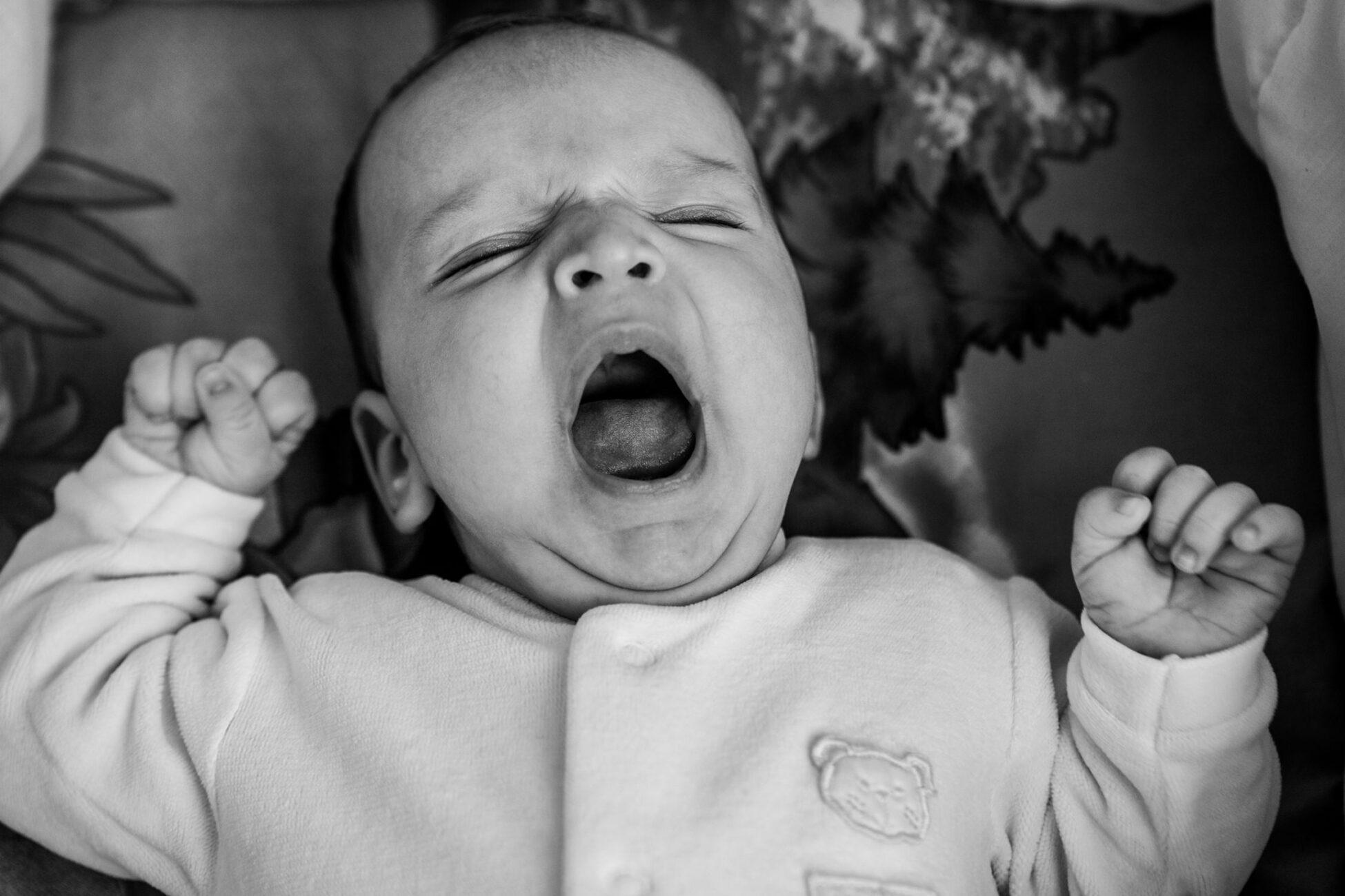 newborn baby boy yawning