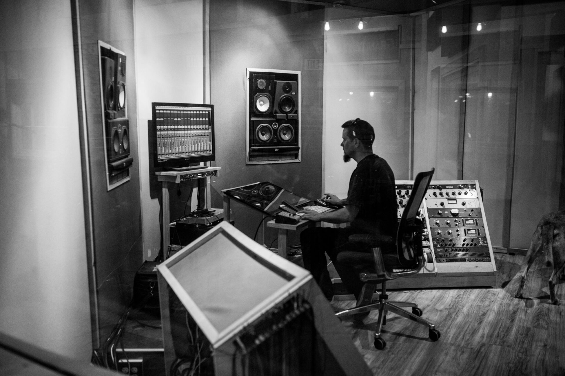 branding photography session - man working at a recoding studio desk
