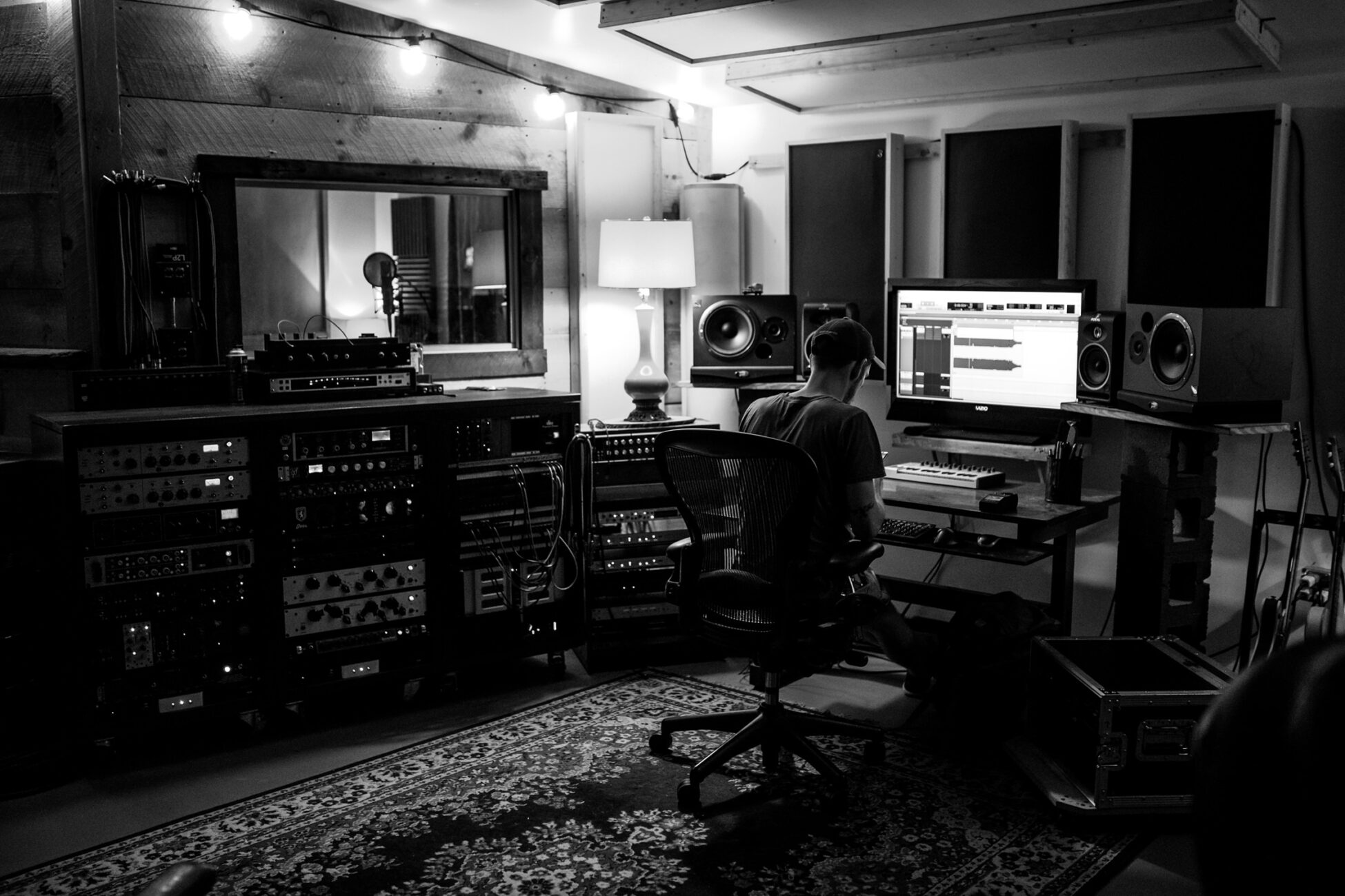 man working at a recording studio during a branding photography session