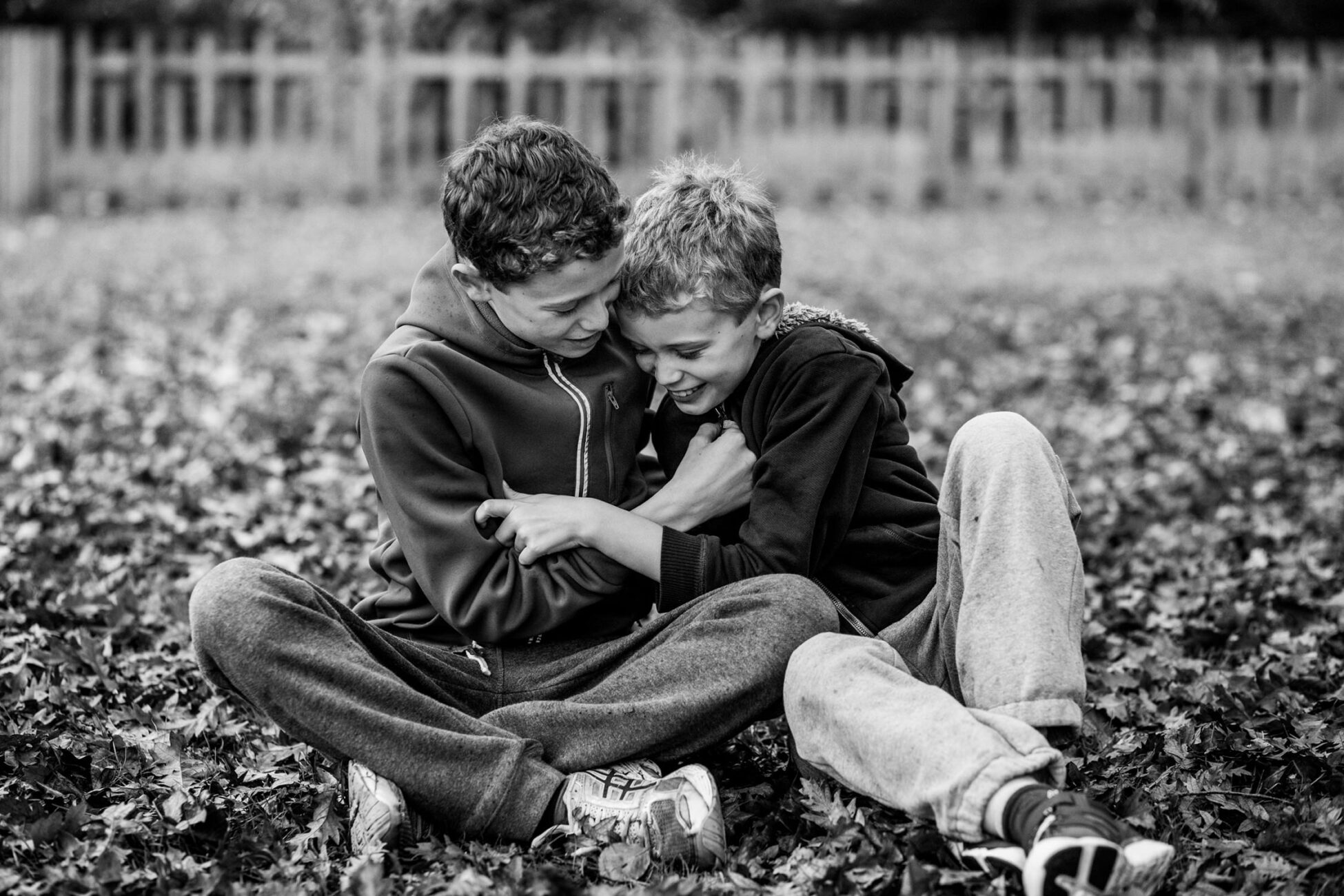 two boys playing together during a family photoshoot in essex